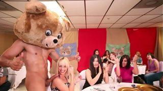 DANCING BEAR – A Bunch Of Horny Women Suck Male Stripper Dicks At A CFNM Party